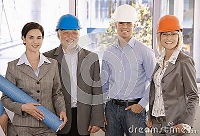 Smiling designer team wearing hardhat
