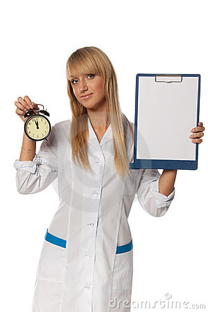 Smiling doctor with blank clipboard and clock