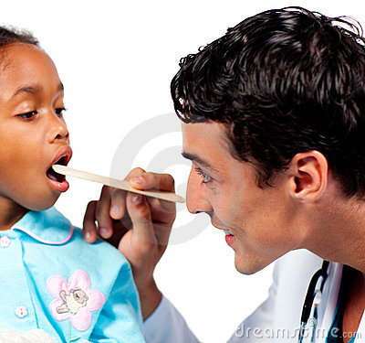 Smiling doctor checking little girl s throat