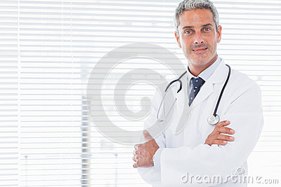 Smiling doctor crossing his arms