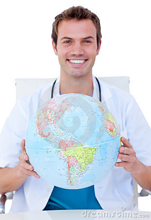 Smiling doctor holding a terrestrial globe