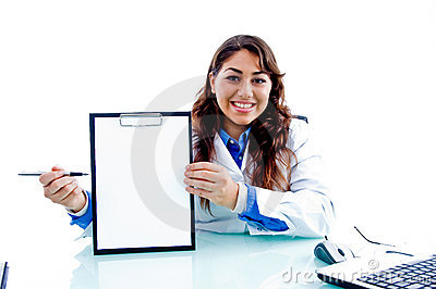 Smiling doctor indicating writing pad