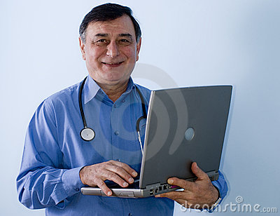 Smiling doctor with laptop