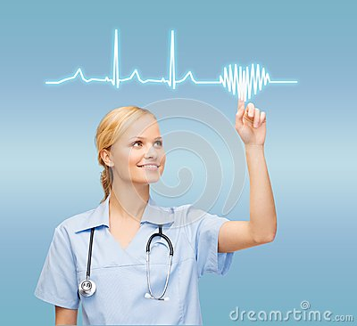 Smiling doctor or nurse pointing to cardiogram