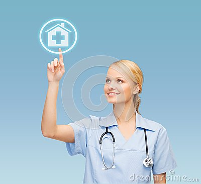 Smiling doctor or nurse pointing to hospital icon