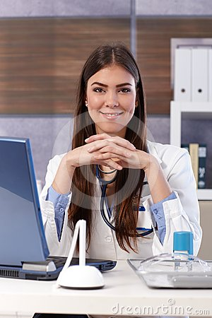 Smiling doctor at office desk