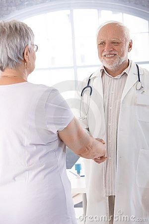 Smiling doctor and patient shaking hands