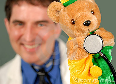 Smiling Doctor with Puppet, shallow DOF