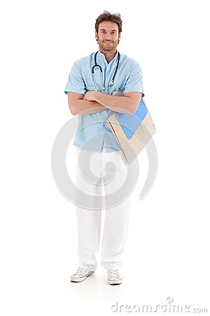 Smiling doctor standing arms crossed