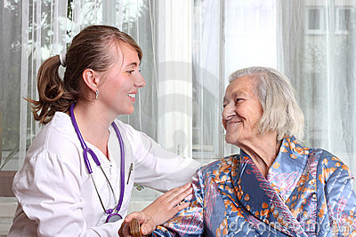 Smiling doctor takes care the senior