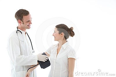 Smiling doctor taking a blood pressure reading