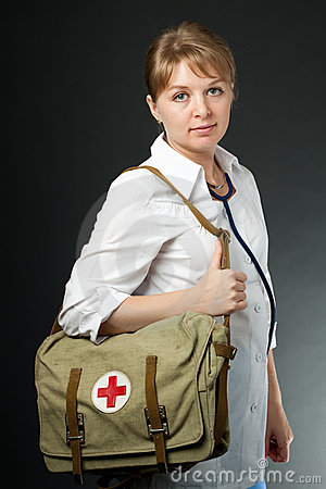 Free Smiling Doctor With Stethoscope And First Aid Bag Stock Images - 19937604