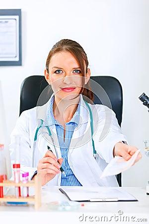 Smiling doctor woman giving medical prescription
