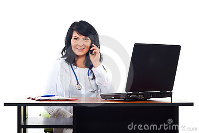 Smiling doctor woman speaking by phone