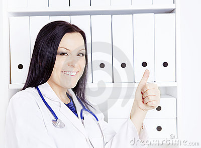 Smiling doctor woman with stethoscope in office