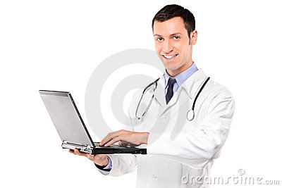 Smiling doctor working on a laptop