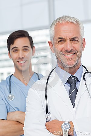 Smiling doctors with arms crossed