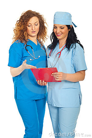Smiling doctors women reading clipboard