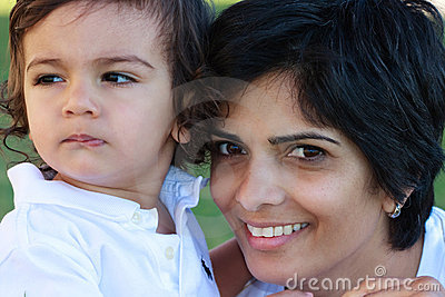 Smiling East Indian mother and young son portrait