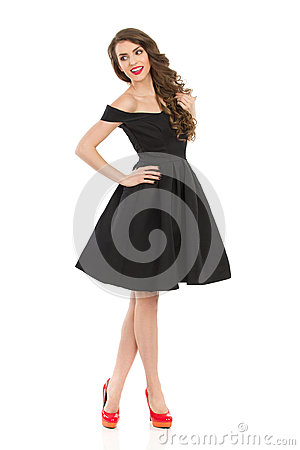 Free Smiling Elegant Woman In Black Cocktail Dress Is Looking Away Royalty Free Stock Photos - 91848708