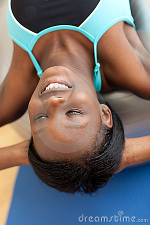 Smiling ethnic woman working out