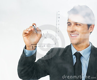 Smiling executive drawing chart on board