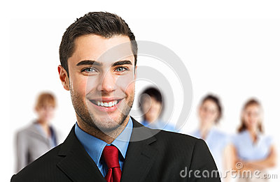 Smiling executive in front of his team