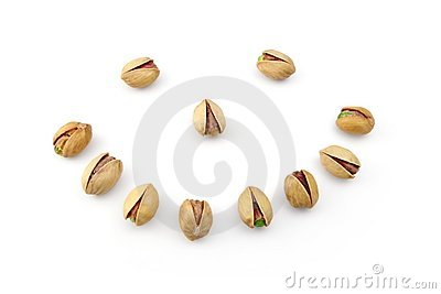 Smiling face made of pistachio nuts