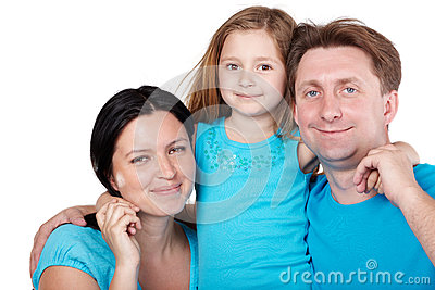 Smiling family, daughter in center hugs parents