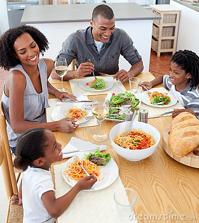 Free Smiling Family Dining Together Royalty Free Stock Images - 12867719