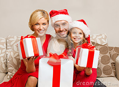 Smiling family giving many gift boxes