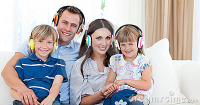 Smiling family listening music with headphones