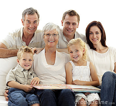 Free Smiling Family Observing Photograph Album Royalty Free Stock Photos - 11583978