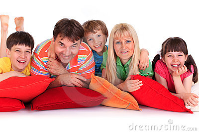 Smiling family on pillows