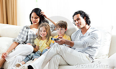Smiling family watching TV