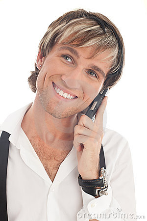 Smiling fashionable man calling by mobile phone