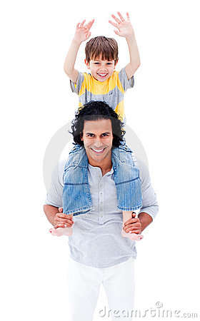 Smiling father giving piggyback ride to his boy