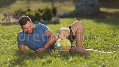 Smiling father and son enjoying leisure outdoors stock video footage