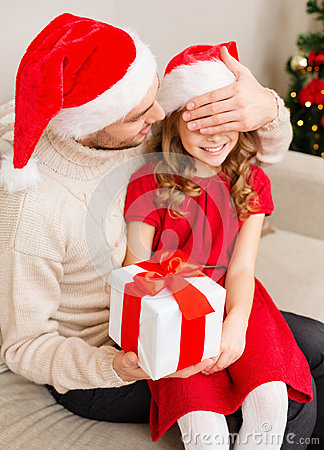 Smiling father surprises daughter with gift box
