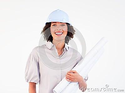 Smiling female architect holding blueprints