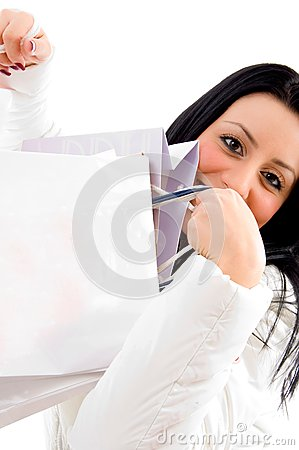 Smiling female carrying shopping bags