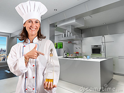 Smiling Female Chef in a cool industrial kitchen