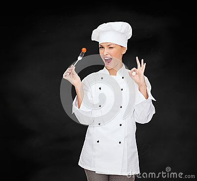Free Smiling Female Chef With Fork And Tomato Royalty Free Stock Images - 37713339