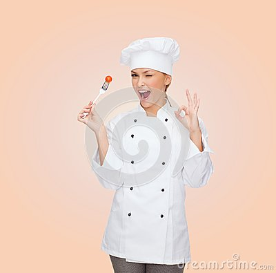 Free Smiling Female Chef With Fork And Tomato Royalty Free Stock Photos - 38432138