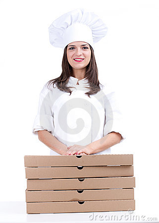 Smiling female cook with boxes of pizza