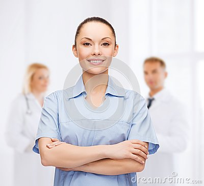 Smiling female doctor or nurse