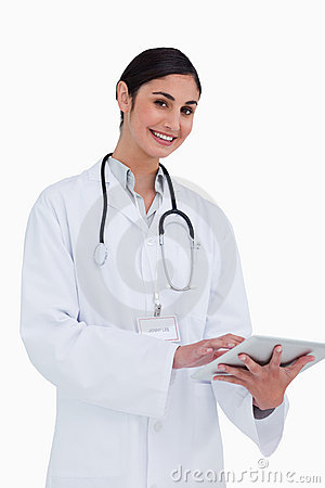 Smiling female doctor with tablet computer