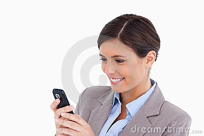 Smiling female entrepreneur reading text message