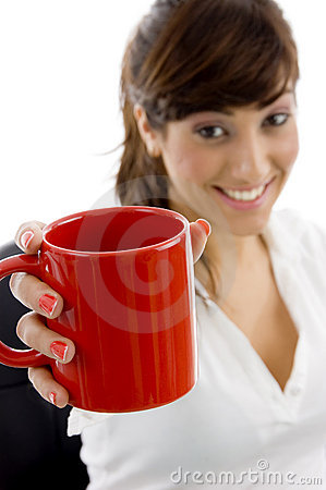 Smiling female executive holding coffee mug