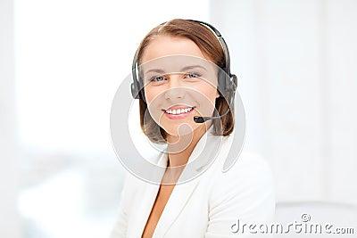 Smiling female helpline operator with headphones